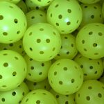 box of pickleballs